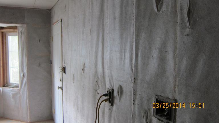 My diy cellulose wall dense pack experience ecorenovator its really easy to flatten out the insulation with a roller heres what it looks like after being rolled solutioingenieria Image collections